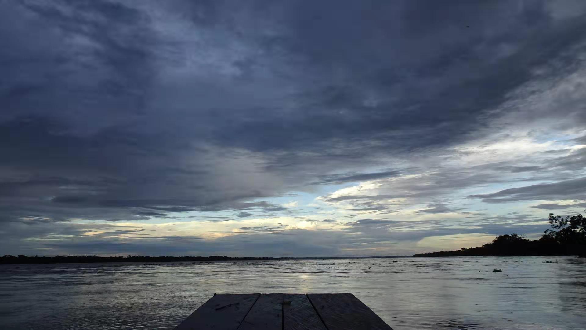 Peruvian sunset in Jungle from boat