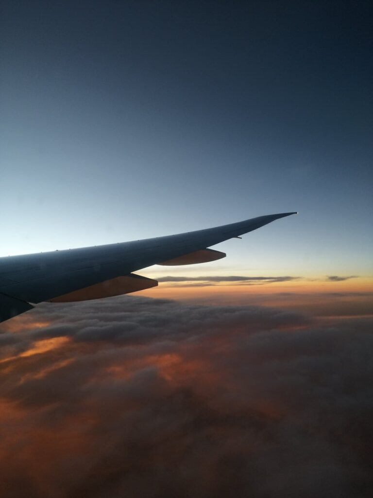Wing at sunset with clouds