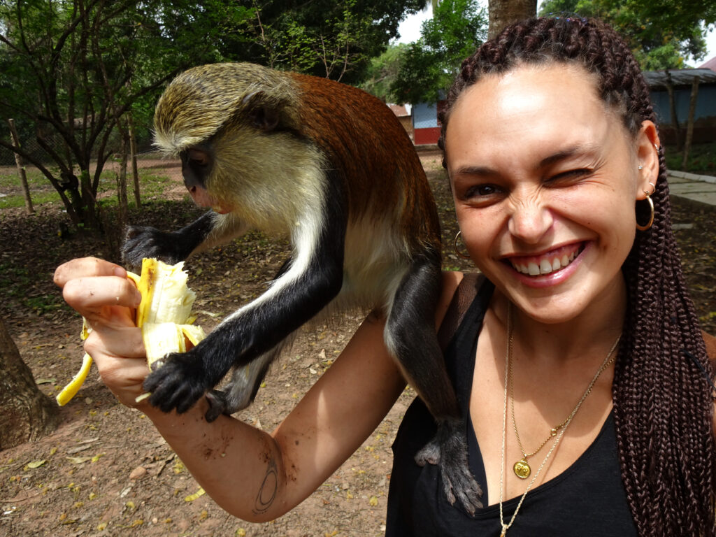 Selfie with Mona Monkey eating banana at the Tafi Atome Sanctuary